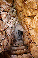 Entrance to Mycenae water cisterns for underground water storage. Excavated by the archaeologist Heinrich Schliemann in 1876.  Mycenae UNESCO World Heritage  Archaeological Site, Peloponnese, Greece