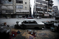 Several artillery mortar shells landed in the Bustan Al-Qasr neighborhood of Aleppo. One of them landed on the opposite side of a bread shop operated by the civilian arm of the Free Syria Army. A total of 10 fatalities were reported by the local medical clinics operating throughout the area. As many as 50 injuries were also reported although these numbers could not be independently verified. ..© Javier Manzano.