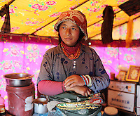 A Tibetan nomad stands inside her traditional tent on the grasslands of the Amdo region on the Tibetan Plateau. Up to 100,000 nomads have been removed from the highland grasslands of the Tibetan Plateau. Climate change, mining and government policy are causing the rapid disappearance of this unique culture.