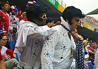 Two American soccer fans dressed up as Elvis display their American colors during the World Cup first round match between the USA and Portugal at Suwon World Cup stadium in Suwon, South Korea on June 5, 2002.