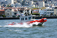 A Defender Class Response Boat (RB-S) searches along the San Francisco Waterfront for a PIW (person in water) after a report of a person jumping from the Golden Gate Bridge. Boat 25531 is one of two RB-S boats based at Station Golden Gate. The RB-S was designed as a homeland security and law enforcement platform to conduct escorts, enforce security zones, and deliver boarding teams. Photographed 4/26/08