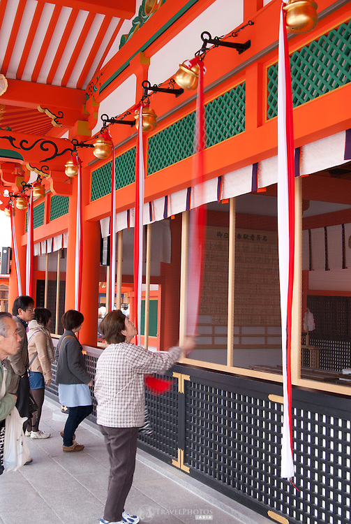 Tourists browsing around the main area of Fushimi Inari Shrine, the shrine for the god of rice.