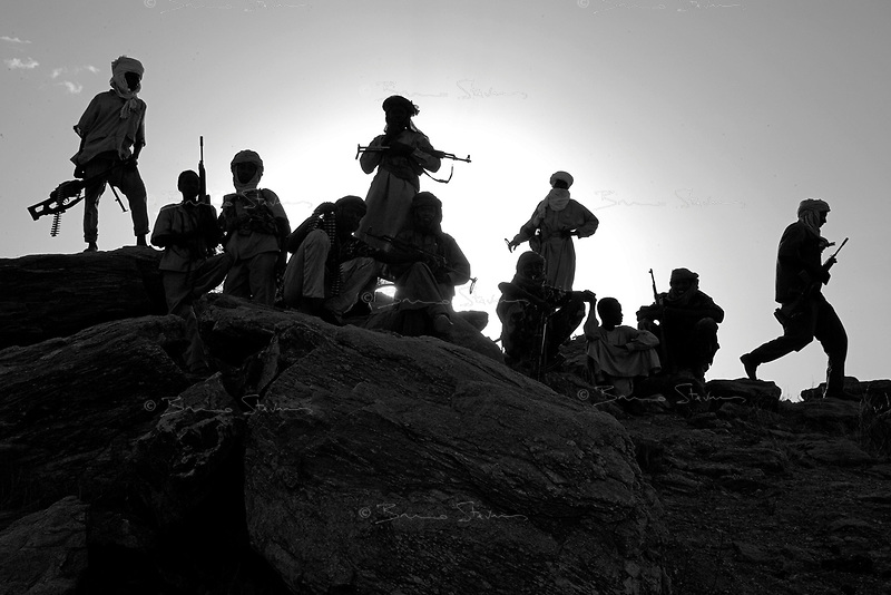 Sinet, Eastern Tchad, June 18, 2004.A well armed Zaghawa militia is protecting big herds of cattle grazing in the area from the repeated incursions of the Janjaweed militia across the border from Sudan.