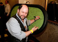 3 March 2007: Celebrity actor Jason Alexander signs the green velvet table while he  arrives at the World Poker Tour Invitational for the fifth annual tournament at the Commerce Casino in Los Angeles, CA.