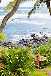 Olympic skier Julia Mancuso heading out to surf near her home on the island of Maui, Hawaii