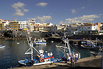 Fishing boats in the harbour of Los Abrigos, Tenerife, Canary Islands, Spain.