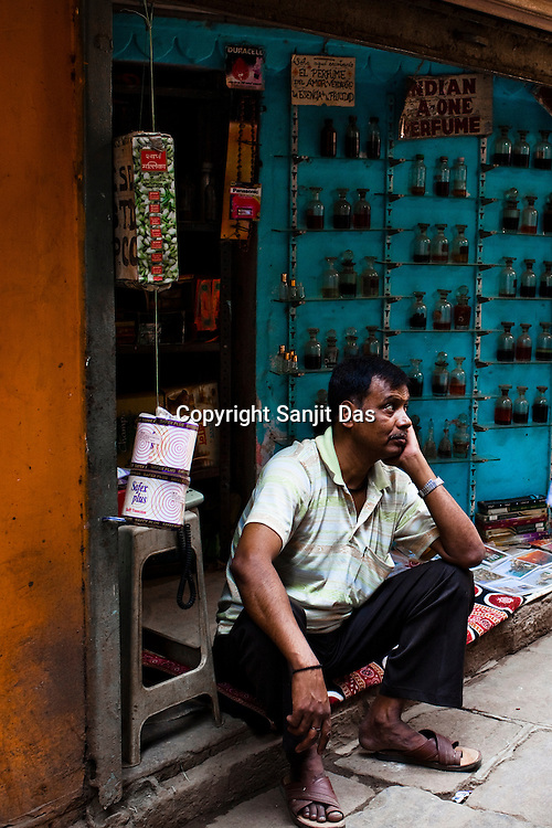 An Itr (indian perfume) shop vendor waits for business in the ancient city of Varanasi in Uttar Pradesh, India. Photograph: Sanjit Das/Panos
