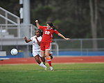 Oxford High's Michelle Reid (23) vs. Lafayette High's Maddie Houghton (20) in girls high school soccer in Oxford, Miss. on Saturday, December 8, 2012. Oxford won 1-0.