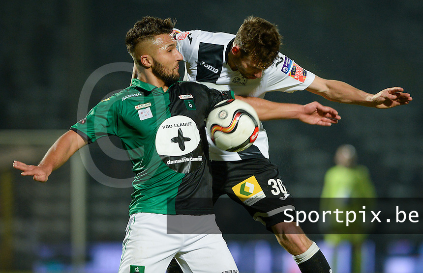 20161217 - ROESELARE , BELGIUM : Cercle's Yvan Yagan (left) pictured with Roeselare's Lukas Van Eenoo (r) during the Proximus League match of D1B between Roeselare and Cercle Brugge, in Roeselare, on Saturday 17 December 2016, on the day 20 of the Belgian soccer championship, division 1B. . SPORTPIX.BE | DAVID CATRY