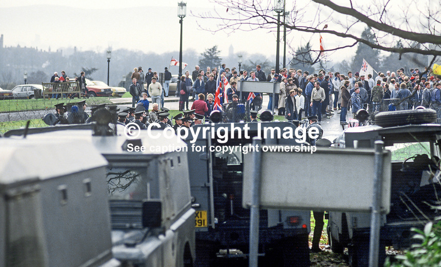 Police prevent Ulster Loyalist protesters reaching Stormont Castle, Belfast, where the first working session of the Anglo-Irish Agreement was taking place attended by the UK Secretary of State for N Ireland, Tom King, and Peter Barry, Minister for Foreign Affairs, Rep of Ireland. 11th December 1985. 19851201AA1.<br /> <br /> Copyright Image from Victor Patterson, 54 Dorchester Park, Belfast, UK, BT9 6RJ<br /> <br /> t: +44 28 90661296<br /> m: +44 7802 353836<br /> vm: +44 20 88167153<br /> e1: victorpatterson@me.com<br /> e2: victorpatterson@gmail.com<br /> <br /> For my Terms and Conditions of Use go to www.victorpatterson.com