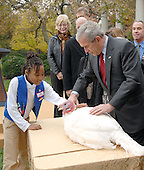 Washington, D.C. - November 20, 2007 -- United States President George W. Bush pardons the 2007 National Thanksgiving turkey in the Rose Garden of the White House in Washington, D.C. on Tuesday, November 20, 2007..Credit: Ron Sachs / CNP