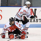 Joel Malchuk (RPI - 13), Cody Ferriero (Northeastern - 79) - The visiting Rensselaer Polytechnic Institute Engineers tied their host, the Northeastern University Huskies, 2-2 (OT) on Friday, October 15, 2010, at Matthews Arena in Boston, MA.