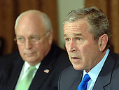 Washington, D.C. - January 24, 2007 -- United States Vice President Dick Cheney listens as U.S. President George W. Bush makes a statement to the press during a meeting with military leaders in the Cabinet Room of the White House on January 24, 2007.  .Credit: Roger L. Wollenberg - Pool via CNP