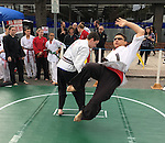 Merrick, New York, USA. 27th September 2015. Two students of Goshinkan Jujitsu Dojo Family Self Defense Center demonstrate jujitsu moves at the Merrick Fall Festival