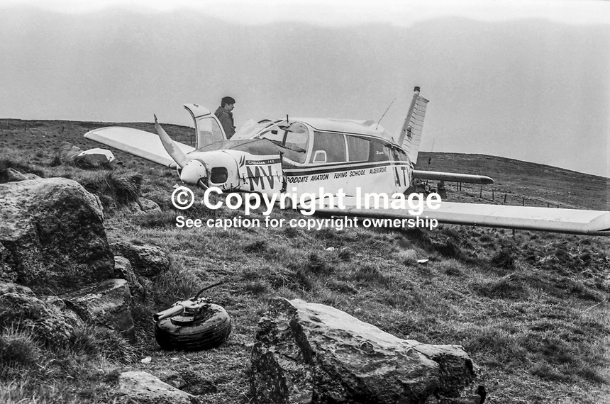 Woodgate Aviation Cherokee which crashed on Black Mountain, near Belfast, N Ireland on Friday 17th May 1974. The pilot was seriously injured, a second man had multiple injuries, and a third man in the rear was uninjured. It is believed they were flying to Woodgate&rsquo;s base at Aldergrove. All three spent the night in the aircraft whilst a nationwide search was taking place. Ironically the wreckage was spotted by an air traffic controller on his way to work at Aldergrove. The party was travelling to N Ireland to see the NW200 motorcycling event. 197405120005<br />