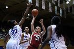 17 December 2014: Oklahoma's Gabbi Ortiz (21) is defended by Duke's Amber Henson (30), Azura Stevens (11), and Elizabeth Williams (right). The Duke University Blue Devils hosted the University of Oklahoma Sooners at Cameron Indoor Stadium in Durham, North Carolina in a 2014-15 NCAA Division I Women's Basketball game. Duke won the game 92-72.