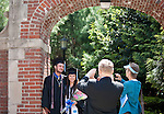 05/19/2013 - Medford/Somerville, MA - Matthew Russell, A13, and Stephanie Howell, A13, pose together for a picture beneath Bowen Gate after Phase I of Tufts University's 157th Commencement on Sunday, May 19, 2013. Legend has it that if a couple who meets at Tufts kisses for the first time in this spot, they will be together forever. (Emily Zilm for Tufts University)
