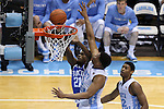 07 March 2015: Duke's Amile Jefferson (21) gets behind North Carolina's Kennedy Meeks (3) and Isaiah Hicks (22) and takes a shot. The University of North Carolina Tar Heels played the Duke University Blue Devils in an NCAA Division I Men's basketball game at the Dean E. Smith Center in Chapel Hill, North Carolina. Duke won the game 84-77.