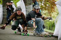 Longboard competition in a park, St.Hanshaugen, in central Oslo. Most participants crashed at one point or another. Morten Beckstrøm (left) sending Alex Lyngås into a tree on his way to victory.