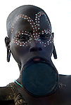 Young Woman with clay lip plate and face painted, Mursi Tribe, Mago National Park, Lower Omo Valley, Ethiopia, portrait, person, one, tribes, tribal, indigenous, peoples, Southern, ethnic, rural, local, traditional, culture, primitive,Africa
