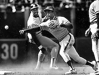 A's Tony Phillips throw to first to complete DP, Dave Winfield out at 2nd. (1983 photo by Ron Riesterer)