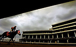 LOUISVILLE, KY-- APRIL 30, 2005-- .A jockey and his horse ride past the recently renovated grandstands and luxury suites following a race at Churchill Downs on opening day. The construction, which started in November 2001, has added 5,000 seats and cost a total of $121 million.<br />