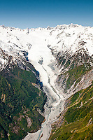 Aerial views of Franz Josef Glacier tongue and its valley, Westland National Park, West Coast, New Zealand