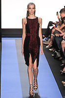 Erjona walks runway in a carbon black crepe cocktail dress with front python lace panel, by Monique Lhuillier, from the Monique Lhuillier Spring 2012 collection fashion show, during Mercedes-Benz Fashion Week Spring 2012.
