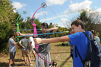 NWA Democrat-Gazette/FLIP PUTTHOFF <br /> Sean Welytok (cq)(left) and Josh Stewart practice archery Oct. 7 2015 during the outdoor education field trip.