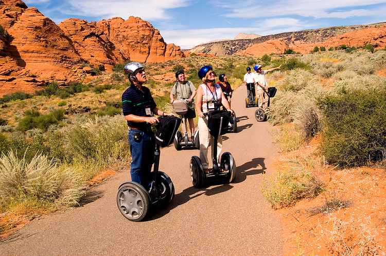 People on Segways at Snow Canyon State Park, Utah, UT, scenic, landscape, Segway riders, Navajo sandstone, rock formations, landforms, arid, Southwest America, American Southwest, US, United States, Image ut413-18595, Photo copyright: Lee Foster, www.fostertravel.com, lee@fostertravel.com, 510-549-2202