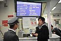 March 17, 2011, Tokyo, Japan - A busline employee at the highway bus terminal in Shinjuku, Tokyo, tells a potential passenger that all seats to Sendai and the northern part of Japan are fully booked through March 22, 2011. Service from March 23 has yet to be determined. (Photo by Atsushi Tomura/AFLO) .