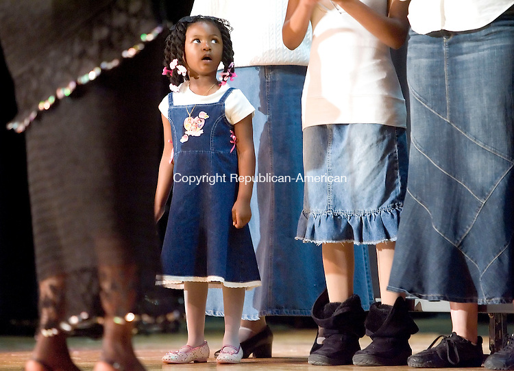 WATERBURY, CT- 04 MAY 2008- 050408JT01-<br /> Richayla Lee Stallings, 3, sings with Chris Davis and the Refuge Reunion Choir during Gospel Fest at Kennedy High School in Waterbury on Sunday. The event was sponsored by the school's Family, Career and Community Leaders of America club.<br /> Josalee Thrift / Republican-American