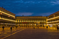 Tourists enjoying the St. Marcus square in Venice, Italy at dusk.