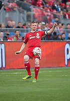 Toronto, Ontario - May 17, 2014: Toronto FC defender Steven Caldwell #13 in action during a game between the New York Red Bulls and Toronto FC at BMO Field. Toronto FC won 2-0.