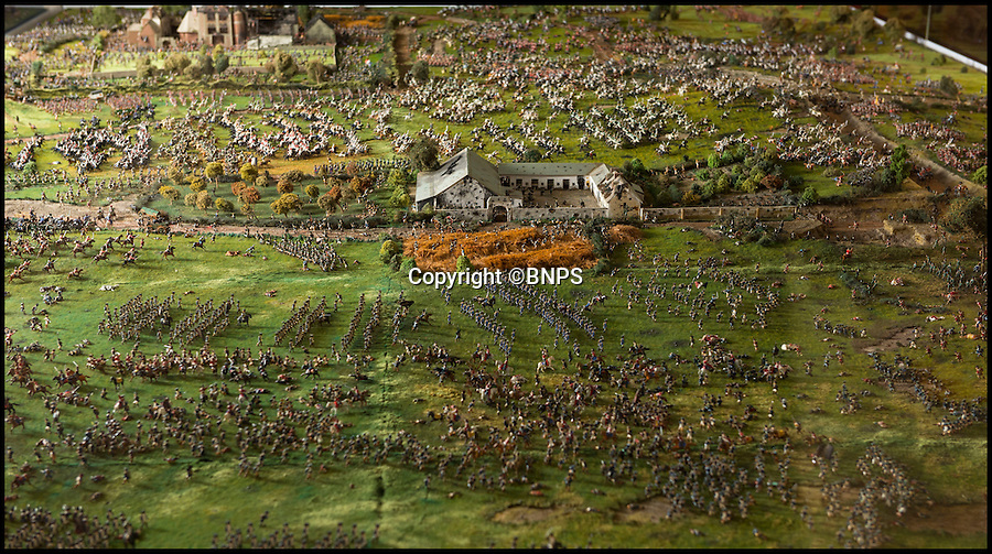 BNPS.co.uk (01202 558833)<br /> Pic: PhilYeomans/BNPS<br /> <br /> View from the east showing La Haye Sainte farm in the centre, and thousands of figures sweeping across the battlefield.<br /> <br /> Historic battle brought back to life...<br /> <br /> A stunning diorama of the battle of Waterloo has been restored to its former glory after a painstaking cleaning operation to remove nearly 50 years of dust.<br /> <br /> The sweeping panorama contain's 21,500 figures and nearly 10,000 horses, each of which has been meticulously cleaned by hand over the last five months by husband and wife team Kelvin and Mary Thatcher from Norfolk.<br /> <br /> The pristine model has now gone back on display at the refurbished Royal Green jackets museum in Winchester.<br /> <br /> A sobering fact is that there were over twice as many casualties in the actual battle as there are figures on the diorama.