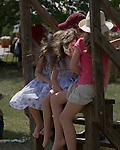 Girls wait for a hay ride through the vineyard during the &quot;Key West Fest&quot; wine festival at Breaux Vineyards in Northern Virginia, USA.