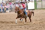 Woman barrel racing, Jordan Valley Big Loop Rodeo, Ore.