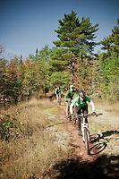A group mountain biking in Copper Harbor Michigan Michigan's Upper Peninsula.