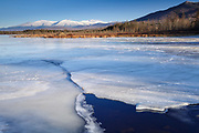 Snowcapped Presidential Range from Cherry Pond at Pondicherry Wildlife Refuge in Jefferson, New Hampshire USA. The Presidential Range Rail Trail (Cohos Trail) passes by Cherry Pond.