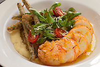 Butter Poached Caribbean Lobster Tail: lemon-parmesan polenta, champagne-tempura haricot vert, saffron-garlic compound butter<br />