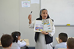 Sister Lemia Atala teaches a class at the Al Bishara School, which is run by the Dominican Sisters of St. Catherine of Siena in Ankawa, near Erbil, Iraq. The students and the Dominican Sisters themselves were displaced by ISIS in 2014. The nuns have established schools and other ministries among the displaced.