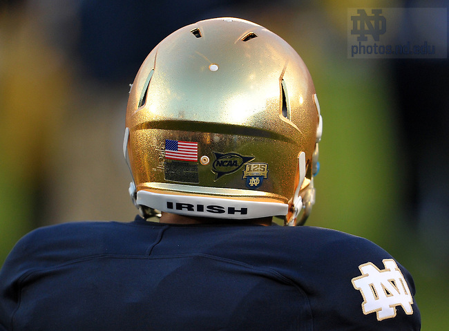 Sept. 22, 2012; The Irish wore special 125th anniversary decals on their helmets...Photo by Matt Cashore