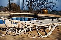 Holly Rd, Santa Barbara, California - Poolside deck chairs melted and burnt from Jesusita fire. May 2009