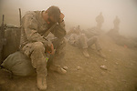 Specialist Greg Weisschaar, left, of the 82nd Airborne, 1/508 Parachute Infantry Regiment, Alpha Company, Third Platoon waits out a sandstorm at Forward Operations Base Diablo in Kandahar province on Friday, March 30, 2007.