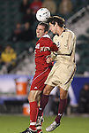 13 November 2009: Boston College's Colin Murphy (21) and NC State's Chandler Knox (left) challenge for a header. The North Carolina State University Wolfpack defeated the Boston College Eagles 1-0 at WakeMed Stadium in Cary, North Carolina in an Atlantic Coast Conference Men's Soccer Tournament Semifinal game.