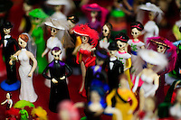Souvenirs are displayed for sell while people take part in the Mexican anniversary of Day of the Dead in the Manhattan neighborhood, New York. 25.06.2015. Eduardo MunozAlvarez/VIEWpress.