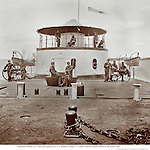 Charleston Harbor, S.C. Deck and officers of U.S.S. monitor Catskill; Lt. Comdr. Edward Barrett seated on the turret,  1865.