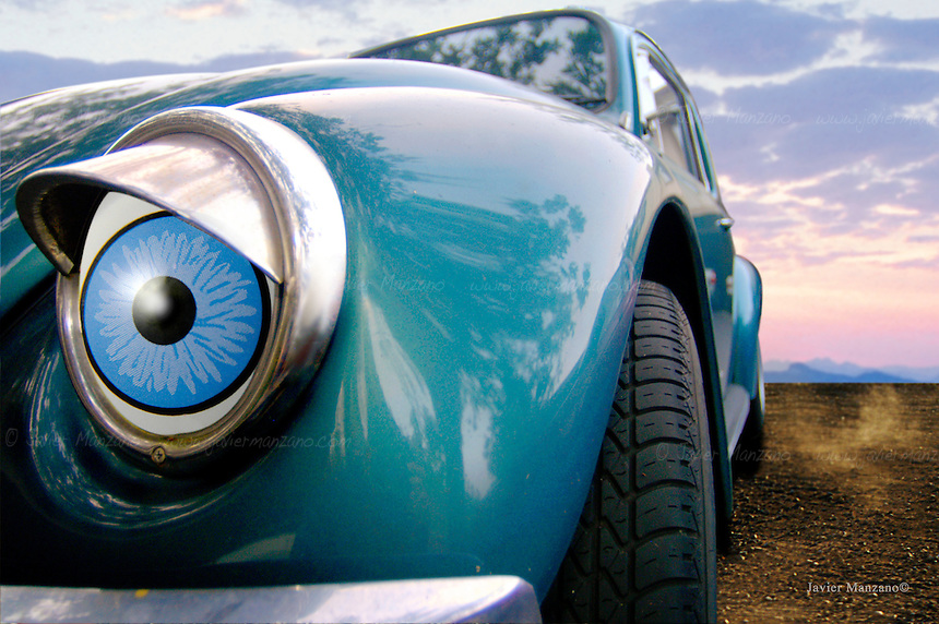 composite of car in desert, with great big blue eyes.