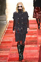 Iselin Steiro walks runway in an outfit from the Tommy Hilfiger Fall 2011 Bohemian Prep collection, during Mercedes-Benz Fashion Week Fall 2011.