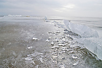 Sea ice breaking against cement jetty in Curonian Lagoon, Nida, Lithuania
